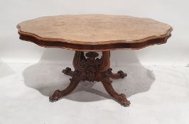 19th century walnut table, the shaped top with moulded edge, on single pedestal support consisting