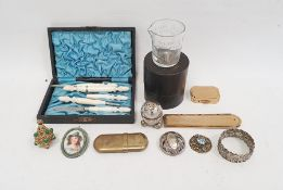 Costume jewellery gilt metal serpent necklace, mother-of-pearl lead necklace, Trifari brooch and a