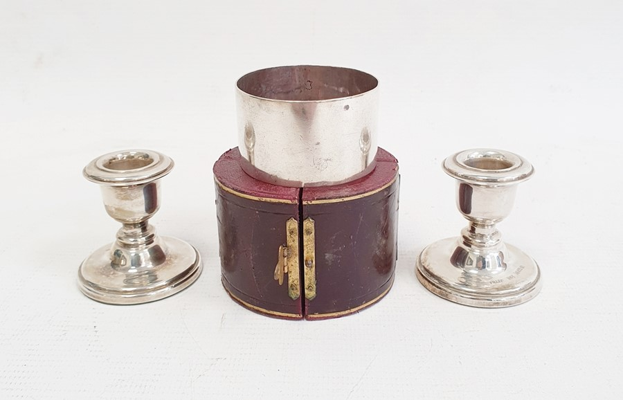 Pair of 1980's silver-mounted squat candlestick holderson circular bases, Birmingham 1984,