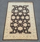 Modern Afghan Ziegler style black ground rugwith cream ground foliate decoration to the field,