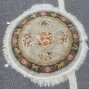 Modern Chinese-style circular rug, the sage ground field with central dragon decoration, the