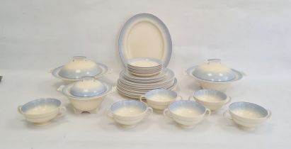 Mid 20th century Royal Doulton pottery part dinner service, cream with banded blue borders,