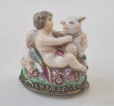19th century French porcelain figural bonbonnierein Chelsea style modelled with cupid and a