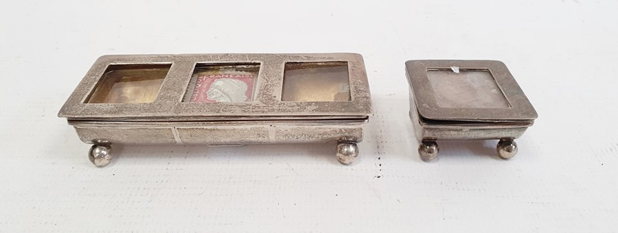 Silver stamp box, Birmingham 1910 of rectangular form, the hinged cover with three apertures and