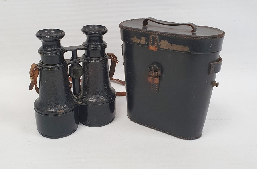 Pair of binoculars marked 'Calvert & Co, Goole, Hezzanith' in case with paper label 'Capt. T.Garnon.