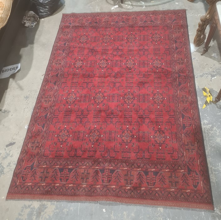Eastern-style rug, red ground with repeating pattern decoration, stepped border, 298cm x 204cm