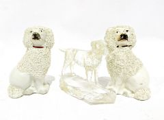 Pair of Staffordshire pottery dogs, 9cm high and a glass model of a dog inscribed New Harris