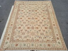 Large modern cream ground rug, the central field with repeating pattern, 367cm x 286cm