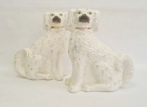 Pair of Staffordshire pottery models of spaniels, circa 1880, modelled in opposing directions, their