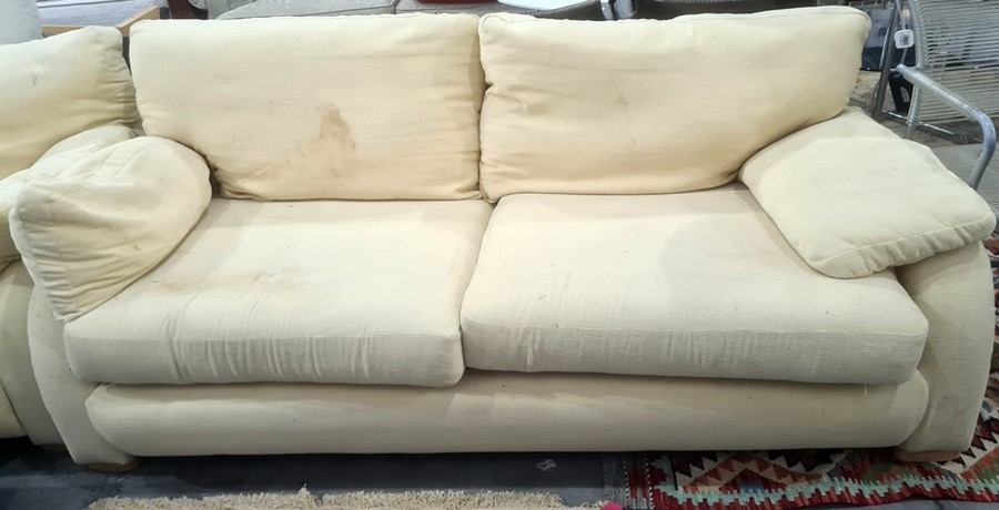 Modern three-seater and two-seater sofas in pale yellow upholstery