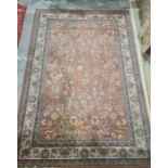 Modern peach ground rug, allover foliate decoration, cream border, 292cm x 200cm
