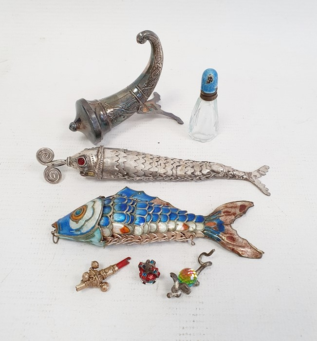 A silver coloured metal and enamel articulated fish in blue, white and orange, another silver