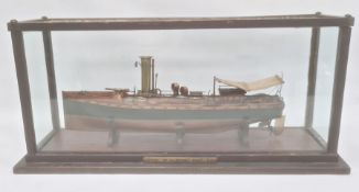 Wood and brass model of a picket boat, RN, having brass funnel and rudder, all in glazed wood