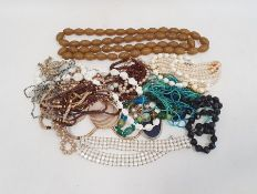Quantity of costume jewelleryincluding long string of bakelite beads, carved bone beads,