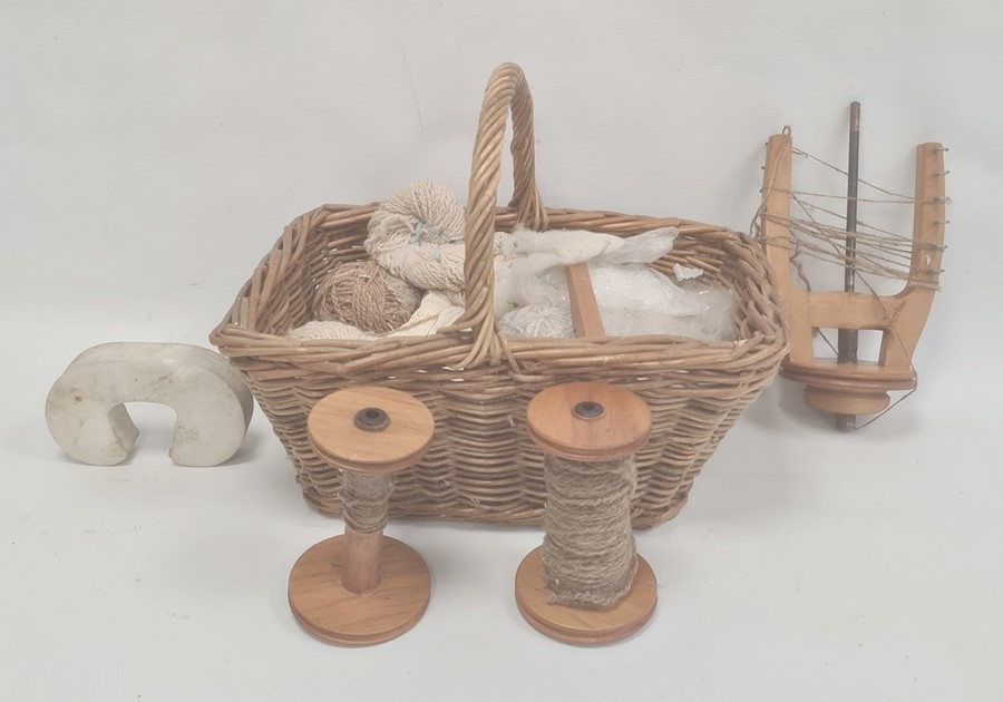 Quantity of weaving implements and wool in small wicker basket