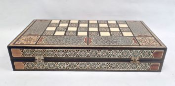 Parquetry inlaid chequerboard games box, hinged with various playing pieces, 51cm wide