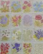 Sixteen silk floral embroidered panels stitched together and glazed, 24 x 19cm