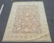 Large fawn ground rugwith allover floral decoration, cream borders, 306cm x 242cm