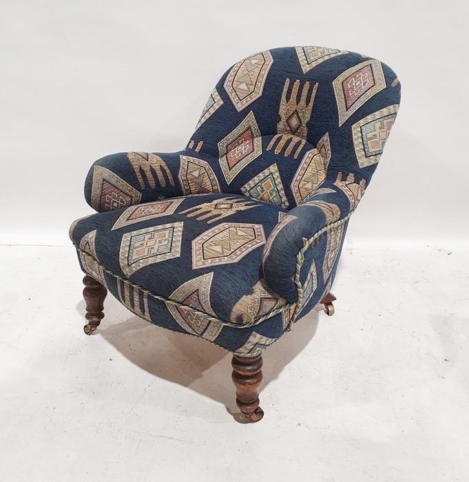 Late 19th/early 20th century armchairby Howard & Sons, reupholstered in blue ground patterned