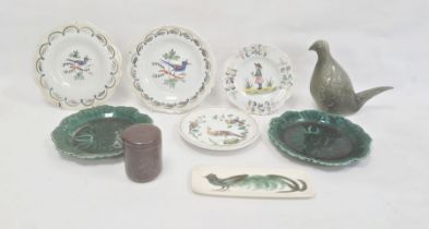 Quimper-style faience platewith figure to centre, another pair, bird decorated, two green leaf