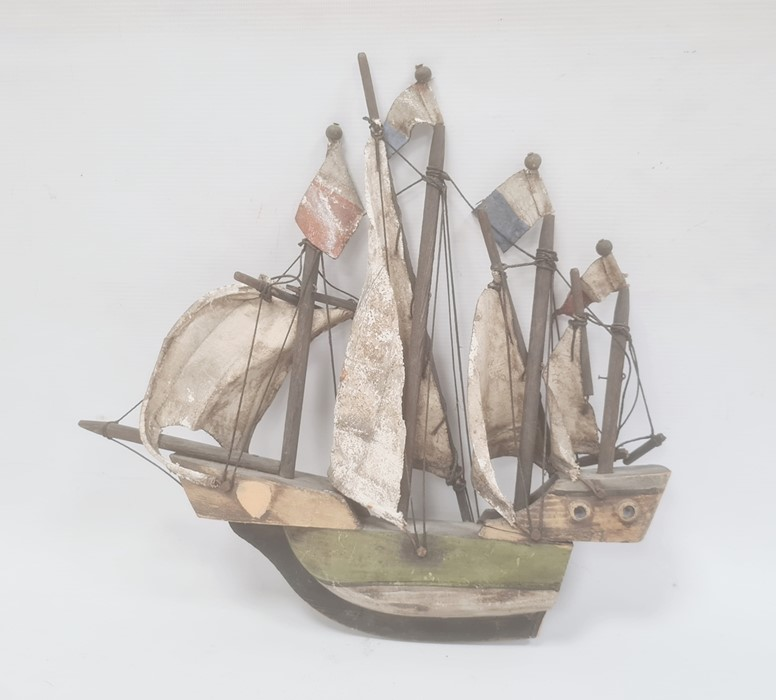 Painted and carved wooden naval model of a quadruple masted sailing galleon, 31cm high x 34cm wide