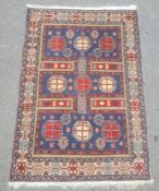 Modern Eastern-style rug, the blue ground field with nine octagonal motifs, in blues, reds,