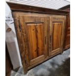 19th century French armoire, the moulded cornice above two panelled doors enclosing shelves, on
