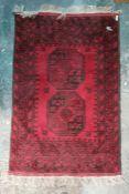 Modern Eastern-style rug, red ground, black decoration, 122cm x 80cm