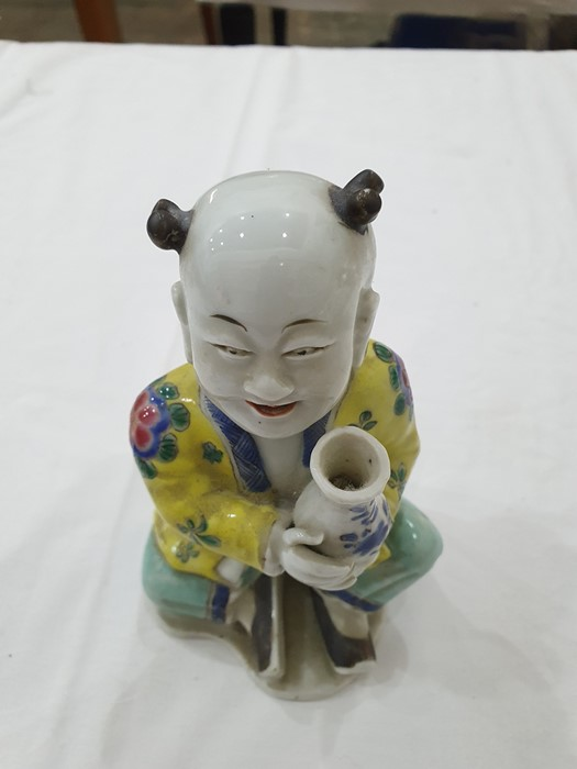 Pair of Chinese porcelain seated figures, laughing boys, each holding a blue and white vase, 16cm - Image 5 of 26