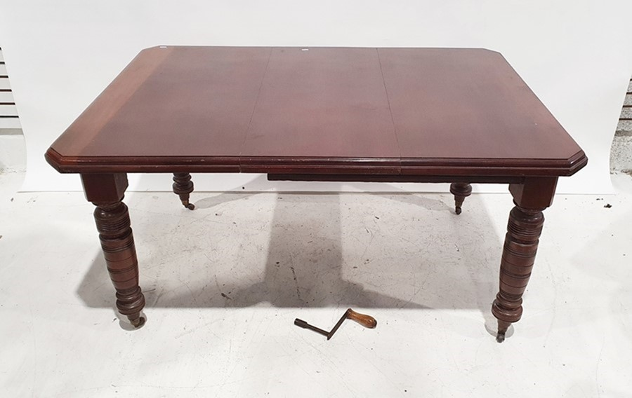 Late Victorian mahogany dining table, the rectangular top with canted corners and moulded edge, on