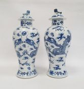 Pair Chinese porcelain vases, each inverse baluster shaped and painted with pair ferocious dragons
