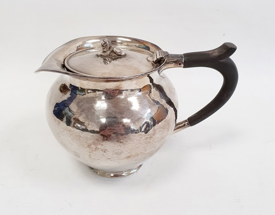 Silver covered jugby A E Jones, London 1911 of circular form with hammered finish, the hinged cover - Image 5 of 12