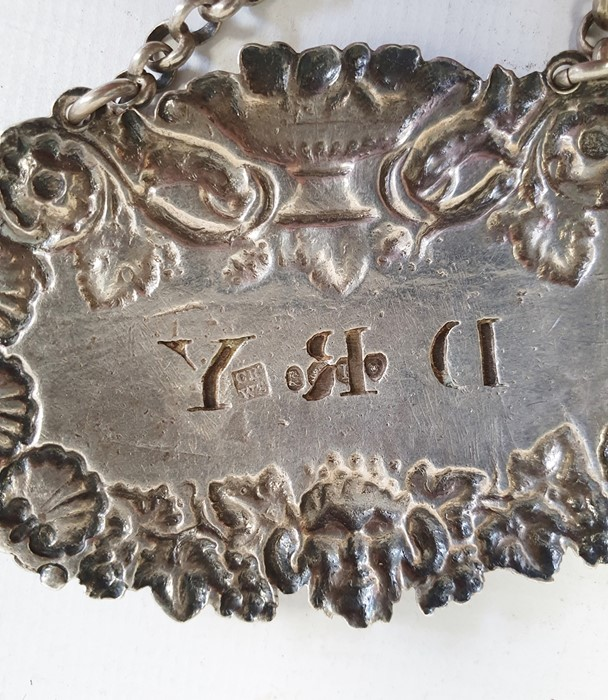 An early 20th century silver Whisky label, 0.5ozt. approx. a silver wine label, 0.9ozt. approx. - Image 2 of 4