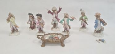 Continental porcelain monkey bandin the Meissen manner, viz:- seven monkeys, some with damage and