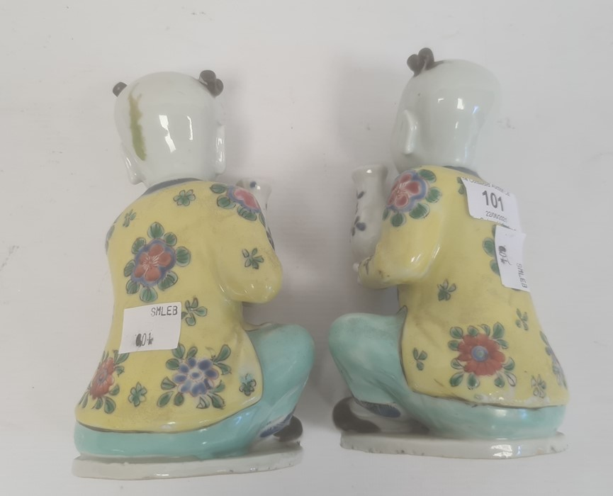 Pair of Chinese porcelain seated figures, laughing boys, each holding a blue and white vase, 16cm - Image 3 of 26