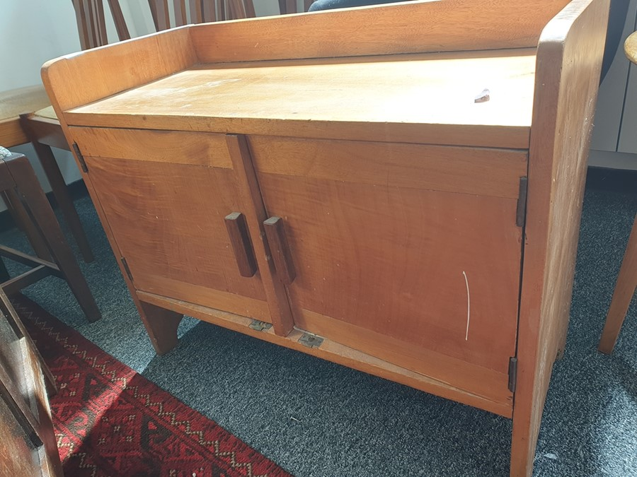 1920's Cotswold School-style low two-door cupboard with three-quarter gallery top above two cupboard