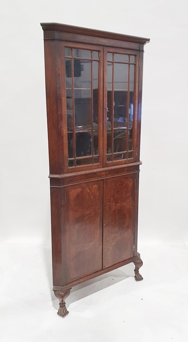 20th century walnut corner display cupboardwith two astragal-glazed doors enclosing shelves, two