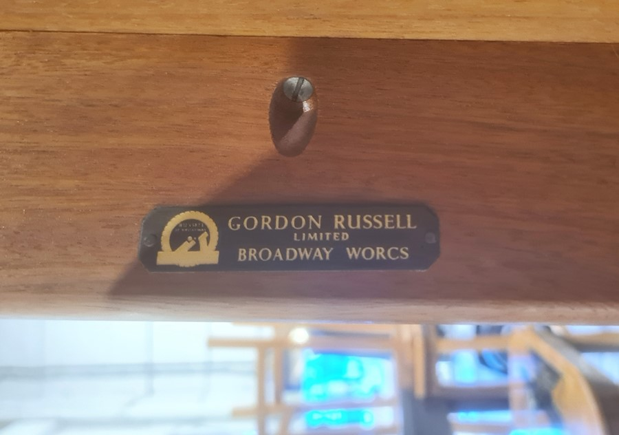 20th century Gordon Russell desk with three drawers, on rectangular section supports bearing label - Image 2 of 2
