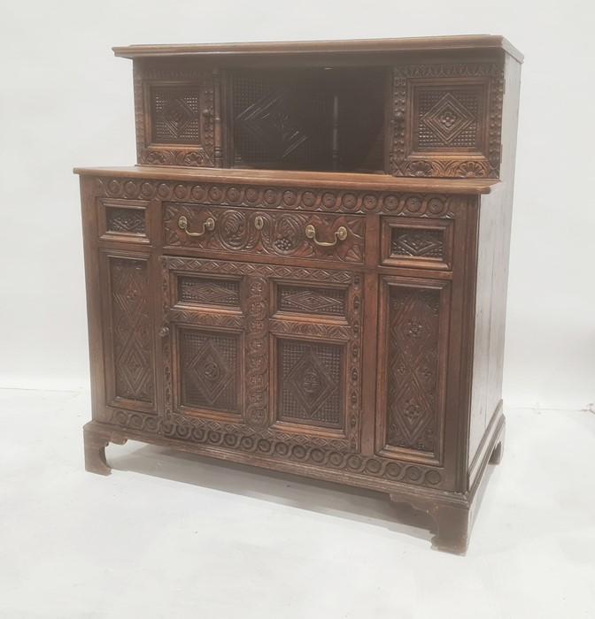 Reproduction oak court cupboardin the Elizabethan taste, with cupboard doors to top above single