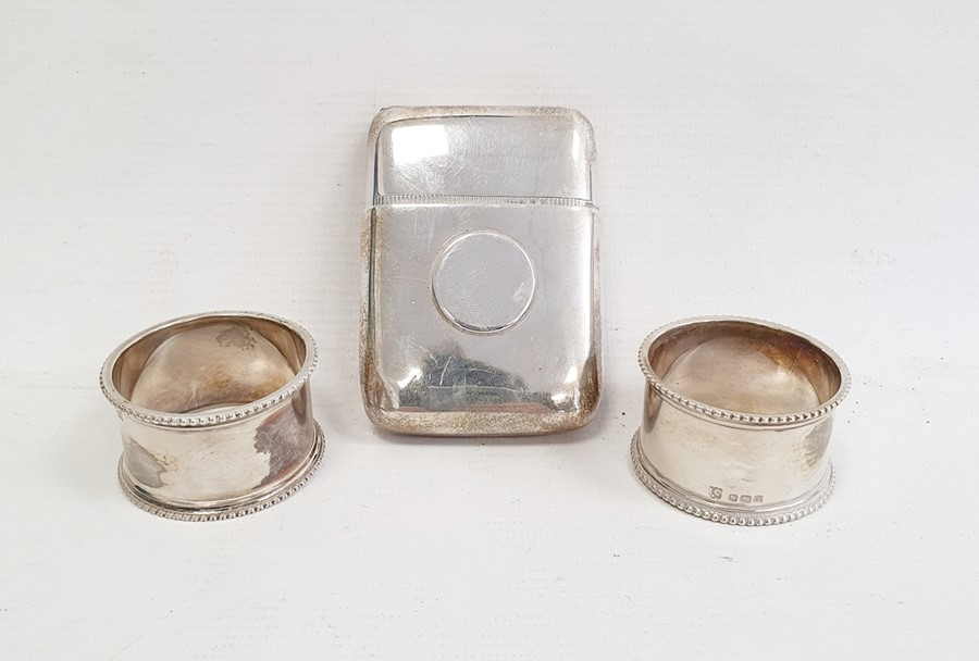 1930's silver cigarette holder, rectangular with circular relief pull-out interior, Birmingham 1933,
