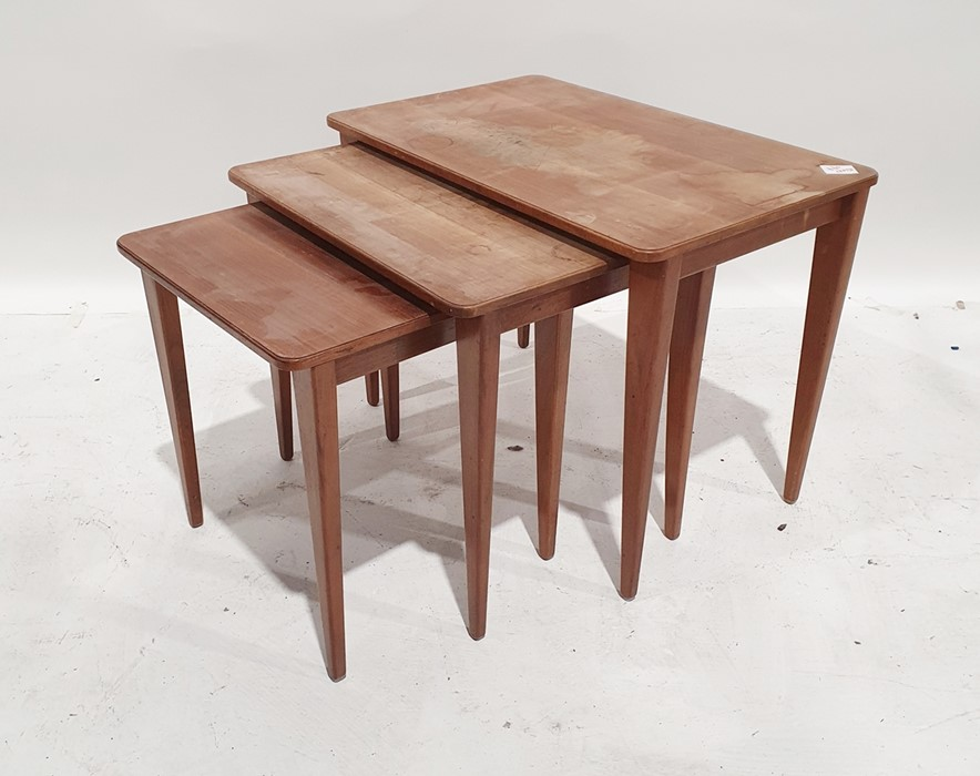 Nest of three mid-century teak Gordon Russell coffee tableson tapering supports