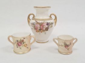 Royal Worcester ivory ground two-handled small vasepainted with a bouquet of flowers within gilt