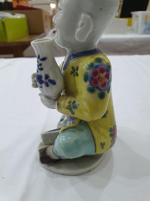 Pair of Chinese porcelain seated figures, laughing boys, each holding a blue and white vase, 16cm - Image 7 of 26