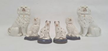 Pair Staffordshire pottery spanielswith gilt highlights, 16cm high, pair smaller Staffordshire