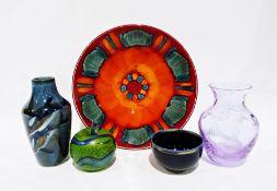 Poole pottery dish decorated in oranges and turquoise, 26.5cm dia., a Cobridge stoneware vase of