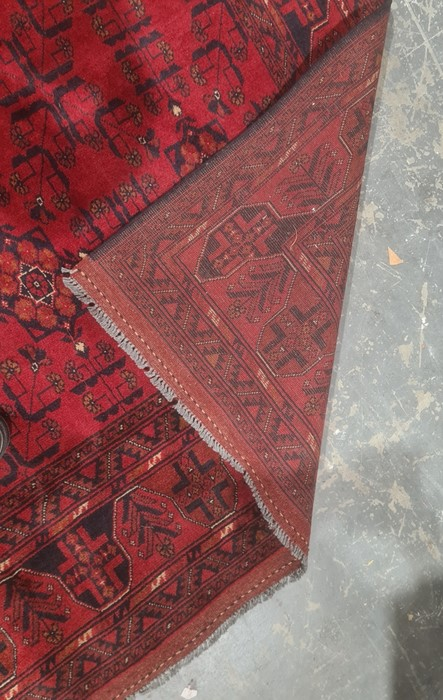 Eastern-style rug, red ground with repeating pattern decoration, stepped border, 298cm x 204cm - Image 2 of 4