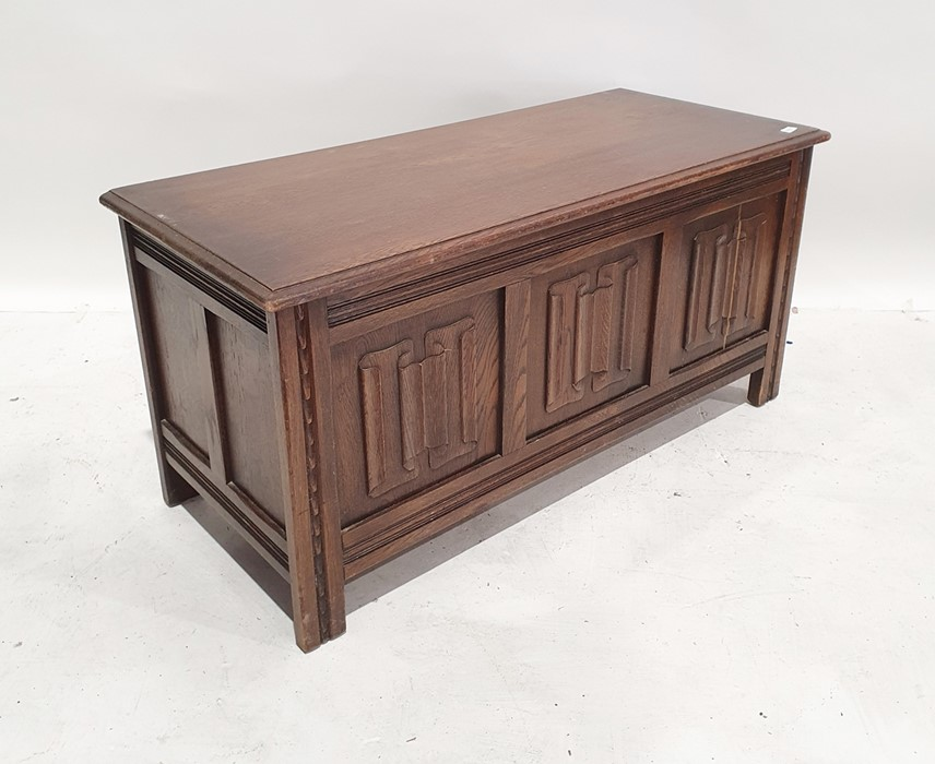 20th century coffer, the rectangular top with moulded edge above three linenfold decorated