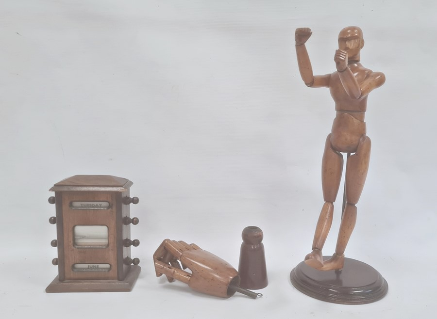 Wooden artist's lay model on circular stand, 40cm high overall, wooden artist's model of jointed