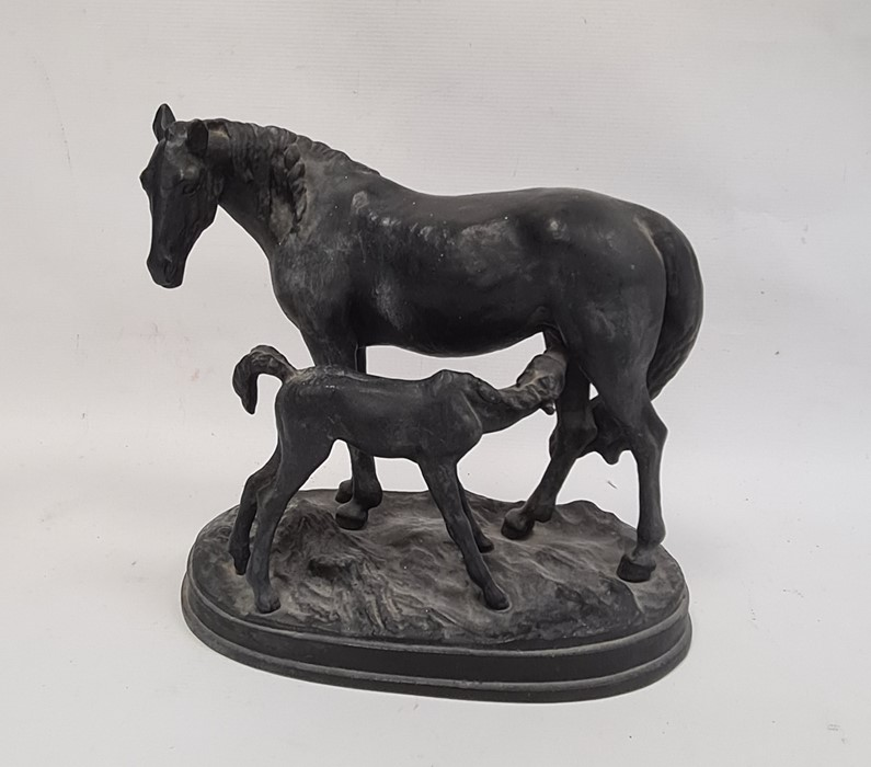 Black painted cast metal group of a mare and foal on oval plinth base, 23cm high