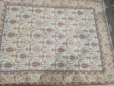 Large modern cream ground rugwith allover decoration of various hooked medallions, etc, stepped